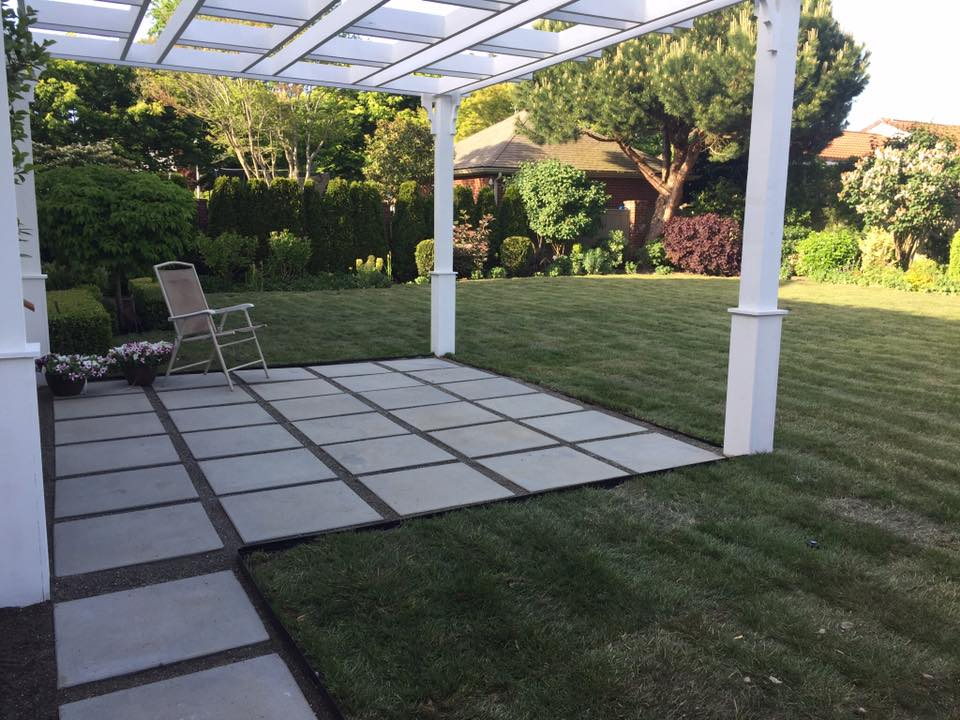 completed pergola with concrete pavers